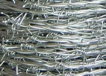 Galvanized barbed wire coil